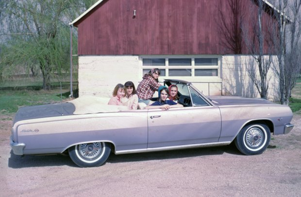 Hubba hubba. . .Chevy Malibu convertible.  The wildest car my parents every owned