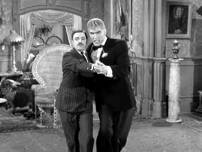 Lurch dancing with Gomez Addams (Lurch is on the right)